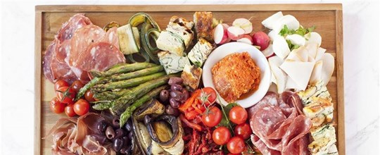 Gourmet antipasto platter - Selection of cured meats, roasted & marinated vegetables and dips, served with freshly cut bread & crackers