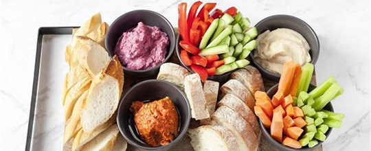 Gourmet dips platter served with crudités and a gourmet bread & cracker selection