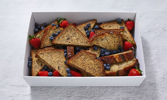 Banana bread slices with berries & butter