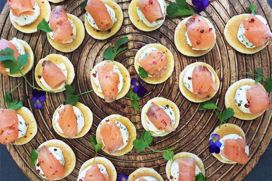 Smoked Salmon, citrus cream on blinis