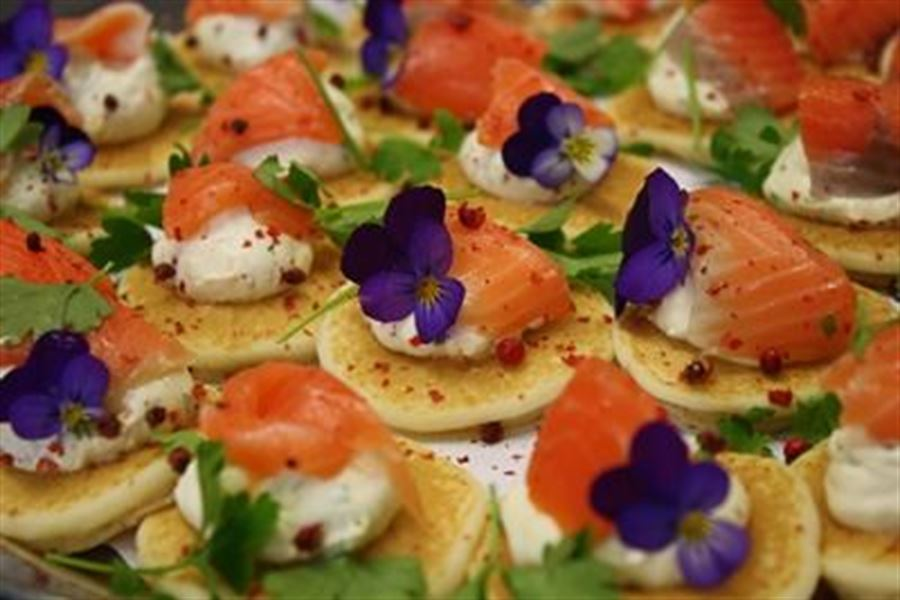 Smoked Salmon, citrus cream on blinis