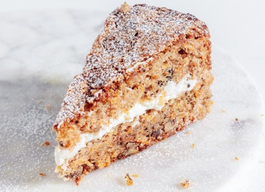 Slice of Carrot & Walnut Cake with Cream Cheese Frosting