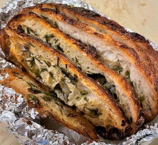 Sourdough confit garlic bread with herbs