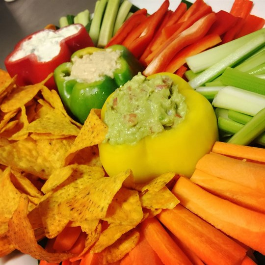 Gourmet dip selection with fresh cut vegetables & organic corn chips