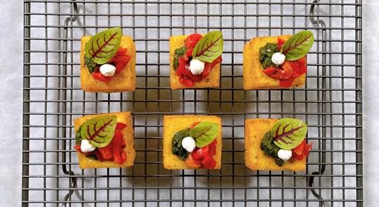 Polenta squares w red peppers, goat's cheese & macadamia pesto