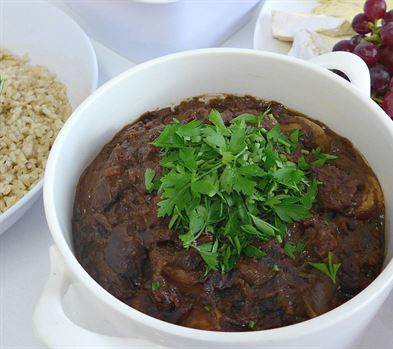 Hungarian pork goulash served with steamed rice and 2 salads