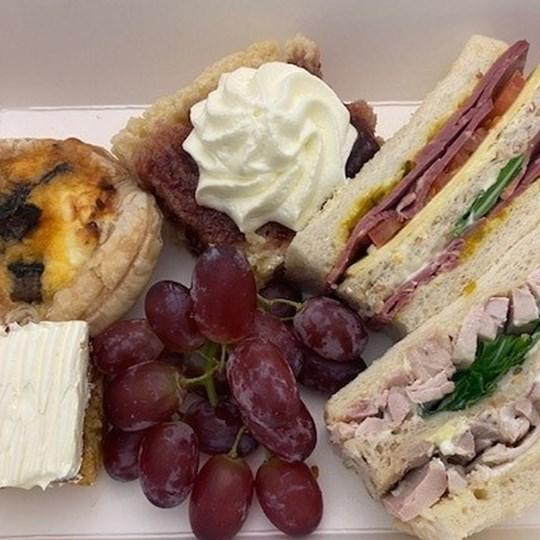 High Tea INDIVIDUALLY BOXED (Window Box) (5 items) - 2 Ribbon sandwiches, 1 x piece scone with Jam & Cream, Orange Almond Cake Piece, Savoury Tart, Fruit Garnish