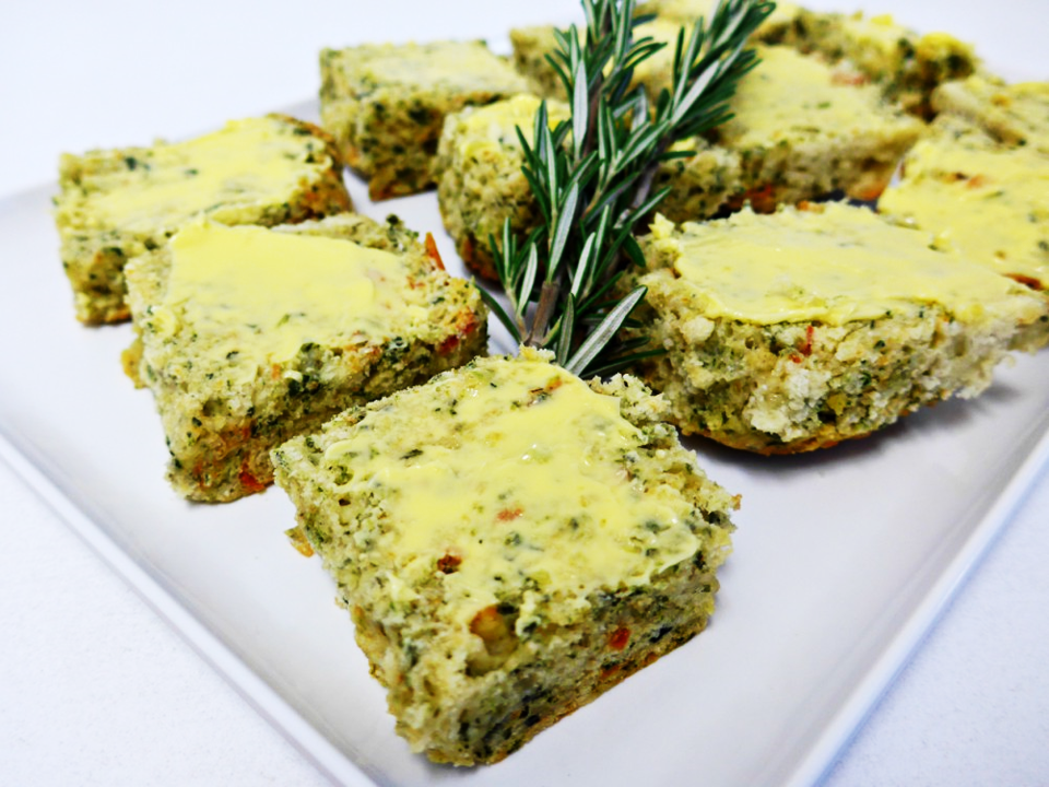 Scone herb savoury half PIECE topped with butter, tasty cheese and fresh herbs (v) (min 6)