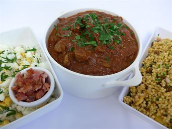 Tomato lamb curry served hot and 2 salads