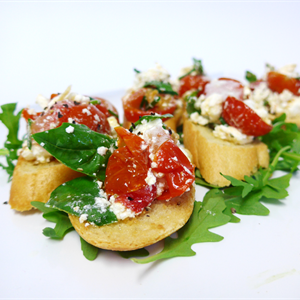Bruschetta with basil pesto, blistered cherry tomato & feta (v) (min 10)
