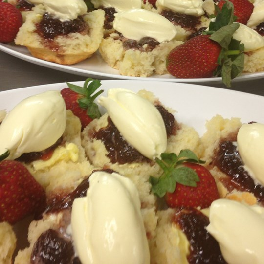 WHOLE Scone, presented open, with jam & cream on PLATTERS