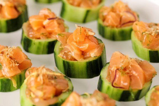 Skuna Salmon Tartare with Red Onion and Bonito Flakes in Cucumber Cups