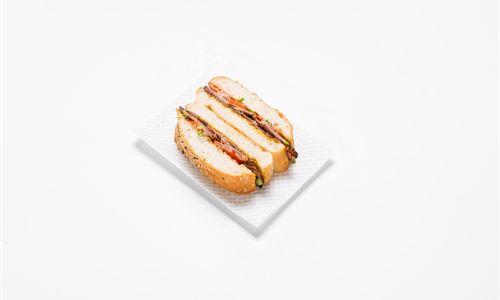 Turkish sandwich - Shaved smoked beef brisket , onion jam, tomato, English mustard
