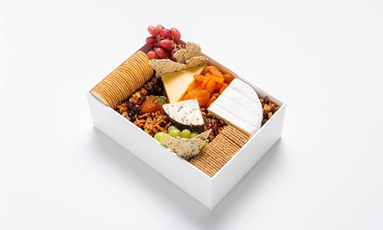 Selection of Whitestone cheese, dried fruit, nuts, crackers, chutney
