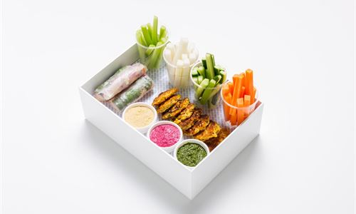 Selection of raw and pickled veg, Vietnamese rice paper rolls, corn fritters, hummus, pesto, garlic aioli