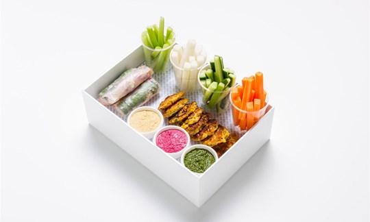 Selection of raw and pickled veg, Vietnamese rice paper rolls, corn fritters, hummus, pesto, garlic aioli