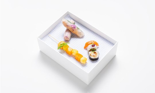 Bento - Asian box, Vietnamese rice paper rolls, sushi w/ pickles, nigiri, pineapple and melon skewer