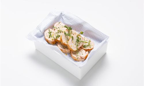 Garlic and herb poached chicken ballotine, citrus gemolata