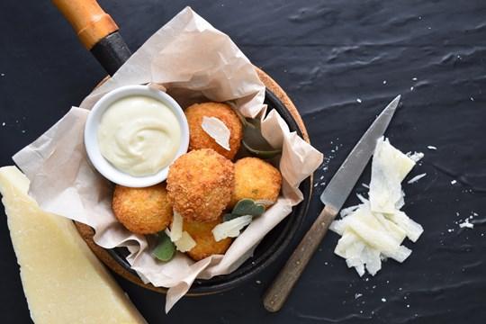 Cauliflower, Truffle, Manchego Arancini with seeded mustard aioli (GF, NF)