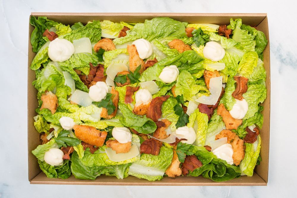 Caesar salad: cos hearts, sourdough croutons, bacon, egg, & parmesan